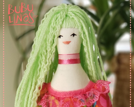 rag doll with pretty green hair and colorful dress