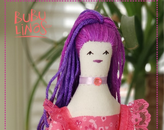 Lovely rag doll with purple hair and pink striped leggings