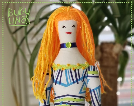 Vibrant rag doll orange hair and long legs