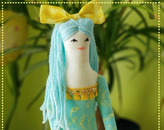 Sweet rag doll with light blue hair and yellow skirt
