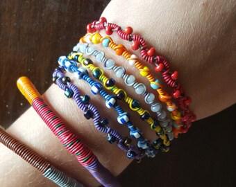 Upcycled telephone wire bracelets