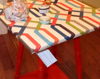 Up-cycled table, with fabric-wrapped top.