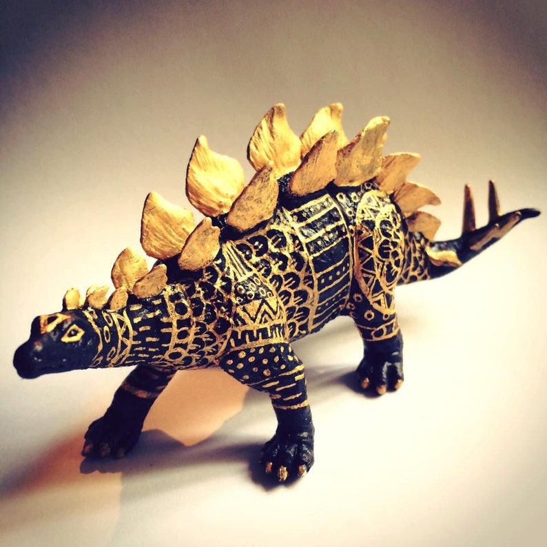 Black and Gold hand painted stegasaurus image 0