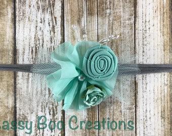 Handmade teal newborn tieback with flowers