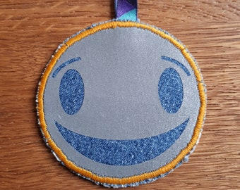 Smiley and lion Safety Reflector, Retro-reflector, up-cycled fabric and reflective fabric, Handmade in Norway.