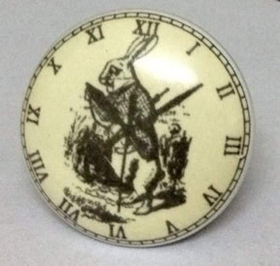 Ceramic Round Drawer Pull/Knob displaying a Clock and a Rabbit