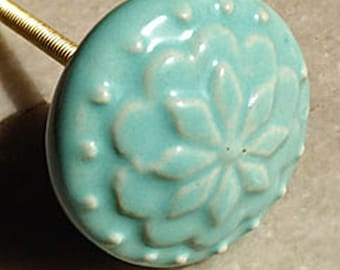 Raised Flower Design on a Round Blue Green Ceramic Knob/Drawer Pull