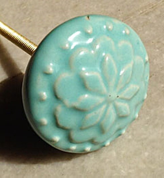 Raised Flower Design on a Round Blue Green Ceramic Knob/Drawer Pull