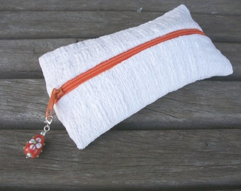 Hand-woven pencil, pure linen, white, structure, with orange zipper and removable pendant with orange glass bead, single piece