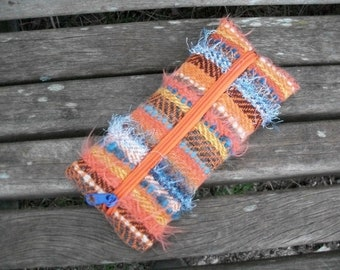 handwoven pencil case for pencils and trifles, orange blue brown mustard yellow, material and texture mix, for organizing in the handbag