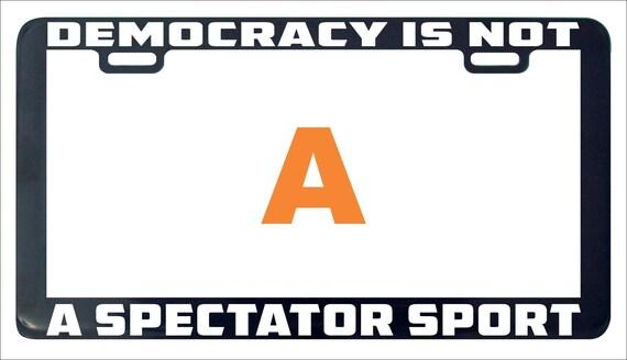 DEMOCRACY ISN/'T A SPECTATOR SPORT LICENSE PLATE FRAME