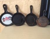 Set of 4 cast iron ashtrays - No Makers Mark