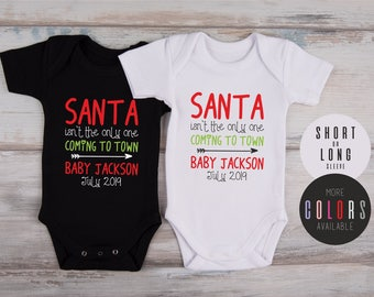 CHRISTMAS PREGNANCY ANNOUNCEMENT, Christmas Pregnancy Reveal To Family, Santa Isn't The Only One Coming To Town Personalized Baby Bodysuit