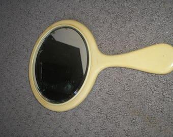 Vintage celluloid round hand mirror
