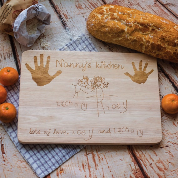 Foodie gift guide: engraved wood chopping board with child drawing and hand prints