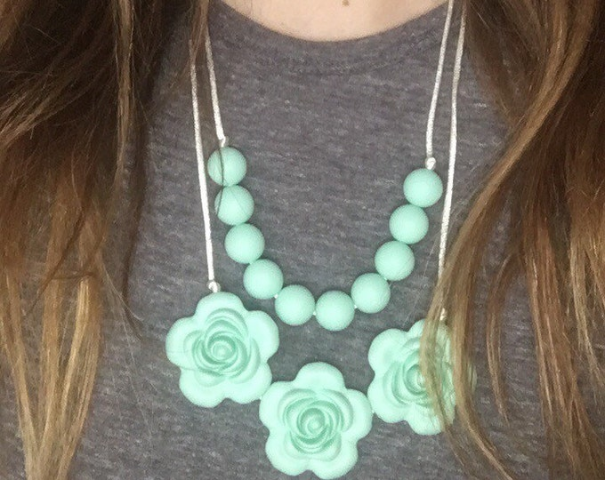 White or mint layered flower necklaces