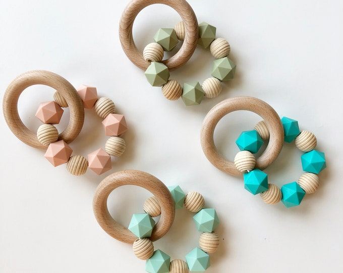 Marble and wood teether-Silicone and natural wood teething toy for teething baby.