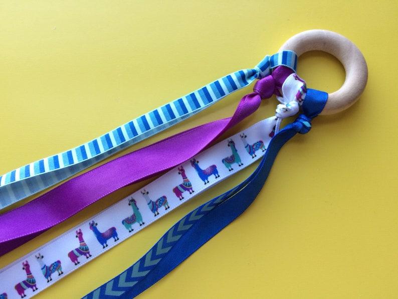 Waldorf hand kite toy natural wood rung and ribbon blue and purple llama great stocking stuffer