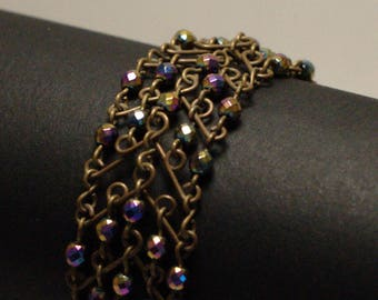 "Large ""V"" brass red/hematite bracelet"