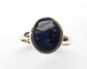 Pretty, oval, blue goldstone ring . Sterling silver. Size P.