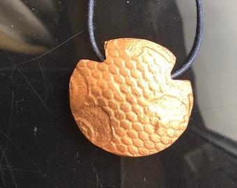 Large, copper, textured lentil pendant. Two sides gives value for money!