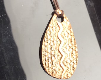 "Textured copper, ""Snake"" pendant. Reversible pendant."