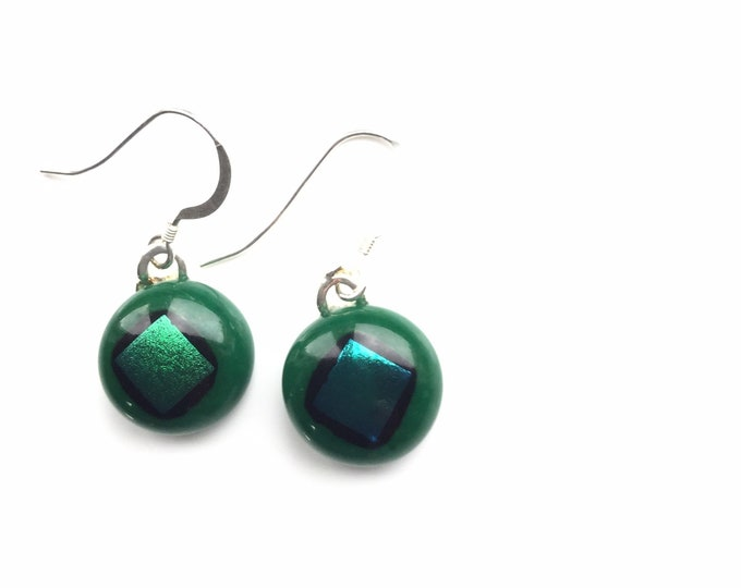 Quirky earrings, mid green and blue dichroic glass. Slight mismatch on the glass makes them different earrings!