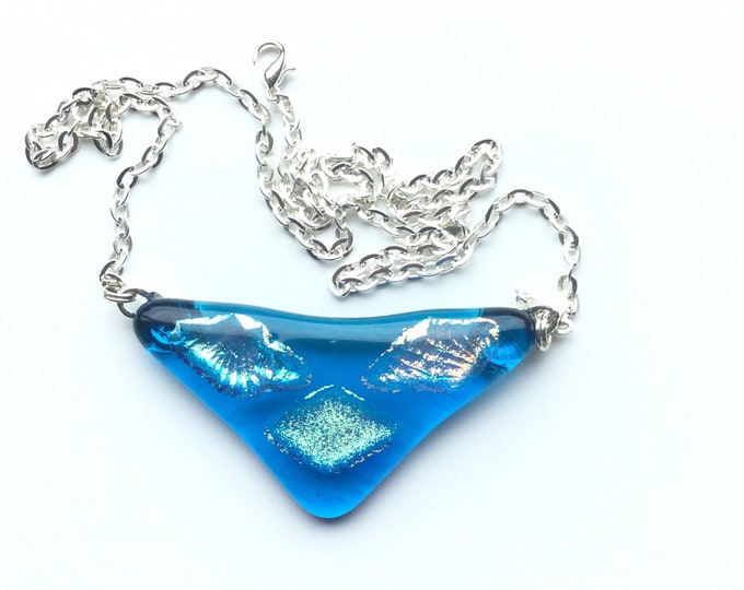 Gorgeous, turquoise and orange dichroic, succulent necklace. This quirky necklace has a seaside feel to it. Aesthetic necklace