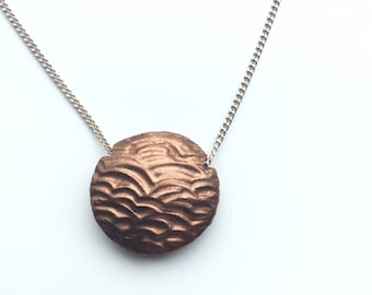 Textured, copper, lentil pendant. Two sided, twice the value!