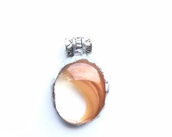 Orange swirl, fused glass pendant, set in copper foil to make a succulent necklace.
