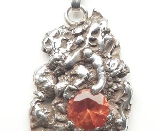 Volcano pendant. Solid silver and lab created paparadasha sapphire pendant