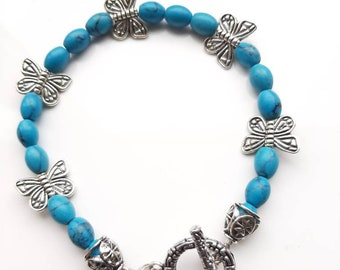 Pretty, Chinese turquoise and Tibetan silver butterfly bracelet.