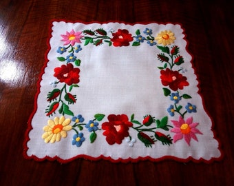 "Hand made 10"" floral doily, embroidered table topper."