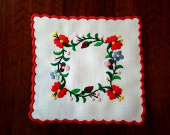 "Hand made 6"" floral doily, embroidered tabletop."