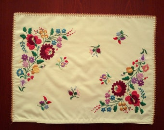 Vintage pillow case with Hungarian embroidery. Home decoration with traditional folk motives.