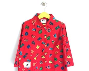 "Printed red pupil apron ""alphabet"""