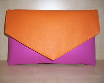 Over sized pink and orange faux leather envelope clutch bag