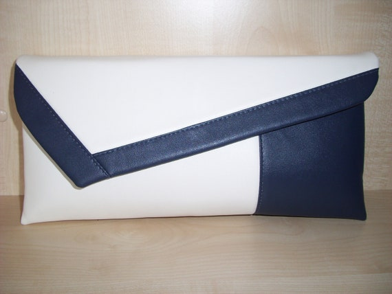 VERY LARGE BLACK /& WHITE faux leather asymmetrical clutch bag with wrist strap.