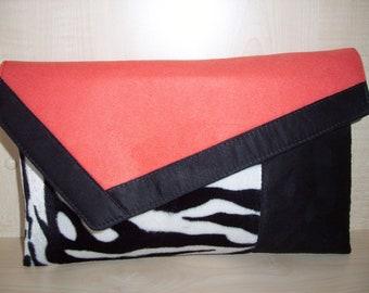 Oversized Burnt orange, zebra print and black faux suede clutch bag