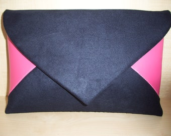 Over sized raspberry pink and navy blue envelope faux suede clutch bag