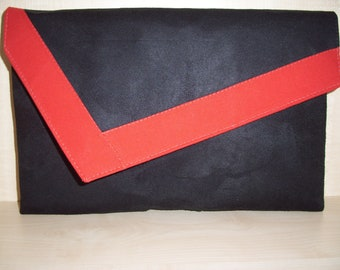 Over sized black and red faux suede clutch bag