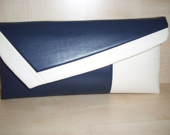 Navy blue and cream/ivory faux leather clutch bag