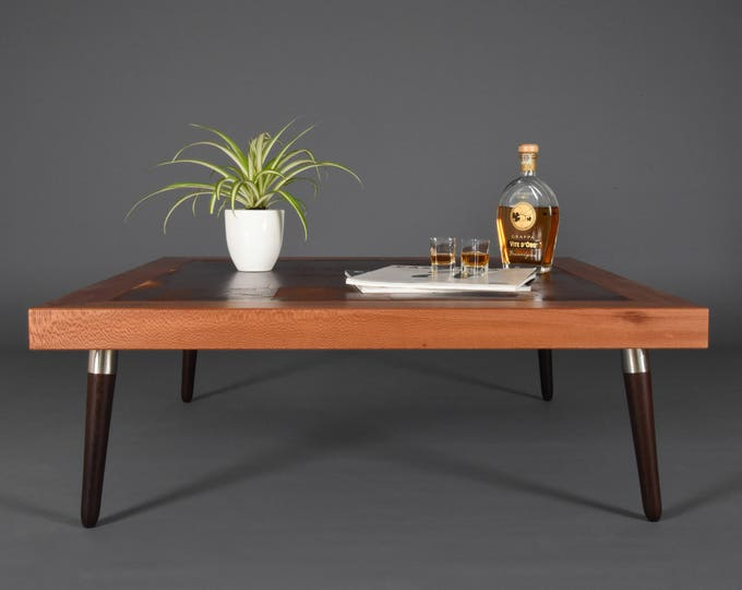Mid-century square coffee table in leather and wood