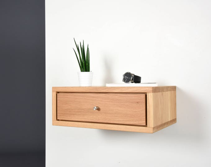 small floating bedside table in solid oak wood with 1 drawer