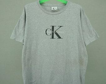 a63a208d8 Calvin Klein T Shirt Men Size L XL 90s Calvin Klein Jeans Tee Vintage  Designer Relaxed T Shirt Made in USA