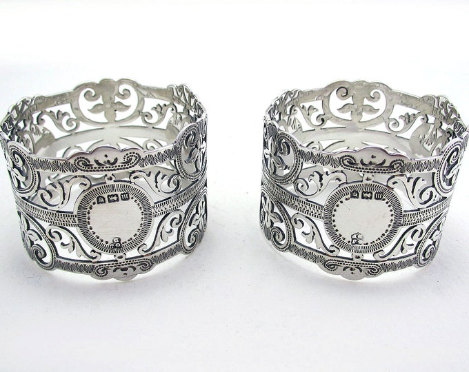 Featured listing image: Pair Antique Edwardian Solid Sterling Silver Pierced Open Work Serviette Napkin Rings. Provincial English Hallmarked Bristol 1907.