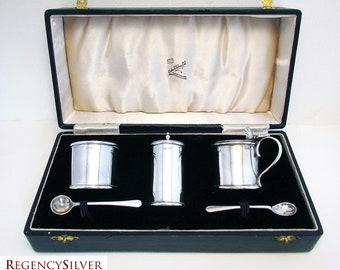 Rare Cooke & Kelvey Indian Colonial era Solid Sterling Silver Cruet Set  (salt cellar, pepper pot, mustard pot, spoons). Early 20th-Century.
