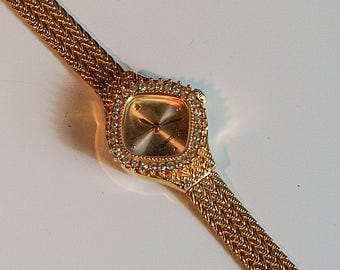 Vintage gold coloured small diamond shaped ladies watch with glass crystal decoration