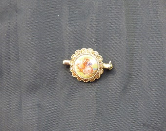 painted brooch