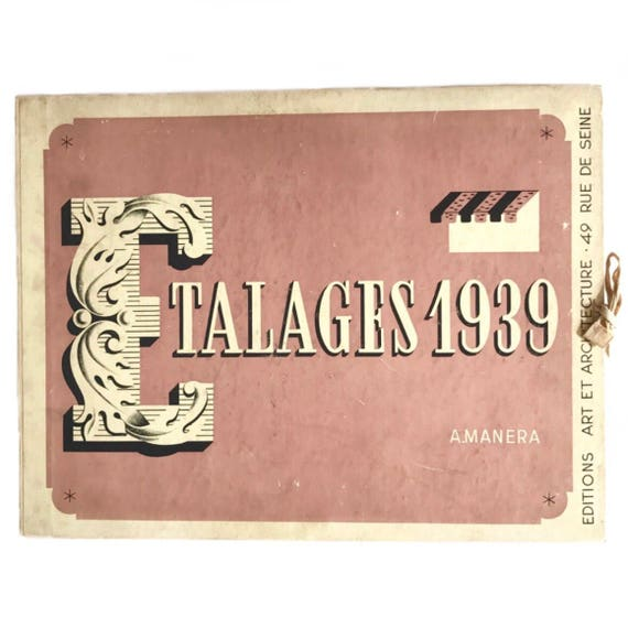 Etalages 1939. Scarce folio of prints of fashion and beauty window displays.